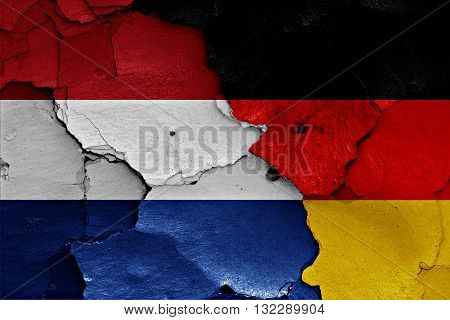Flags Of Netherlands And Germany Painted On Cracked Wall