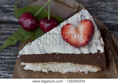 Piece of sponge cake, decorated with strawberry heart.