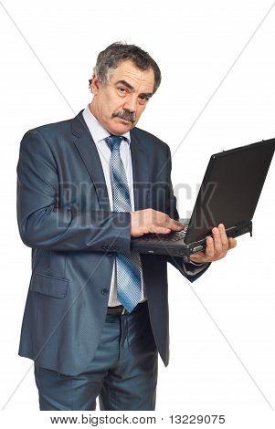 Mature Corporate Man Working On Laptop