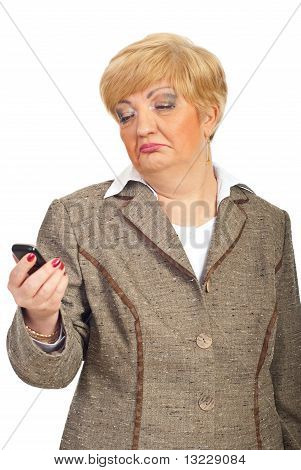 Mature Woman Looks Crooked To Cellphone