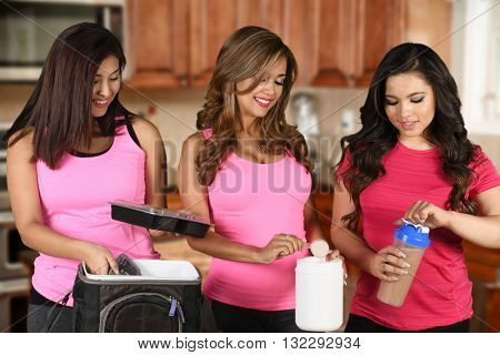 Women working together on prepping meals for the week