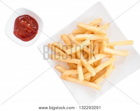Isolated top view of french fries with ketchup - french fried on square white dish with ketchup on white background