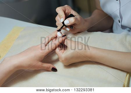 Nails Transparent Coating Is A Close-up In Beauty Salon. Manicure Process.