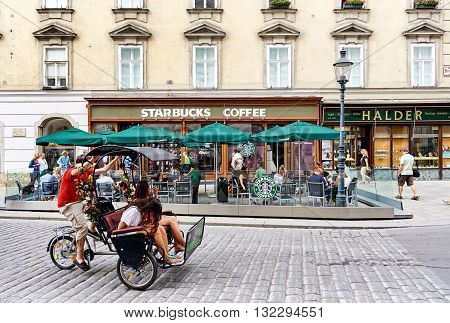 Vienna Austria - August 7 2012: Starbucks Coffee in the center of Vienna. Starbucks is the largest coffeehouse company in the world
