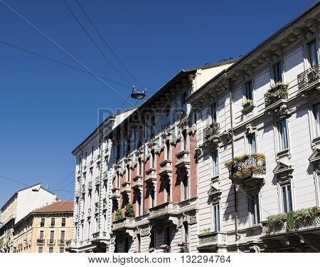 Facade of typical residential buildings in Milan (Lombardy Italy)