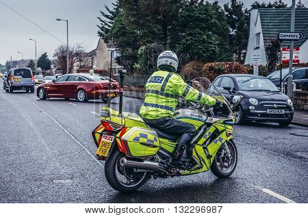 Edinburgh UK - January 20 2015. Police officer on the Yamaha motorbike in Edinburgh city