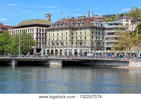 Zurich, Switzerland - 25 May, 2016: people on Bahnhofbruecke bridge over the Limmat river, Central square, Hotel Central Plaza building. Zurich is the largest city in Switzerland and the capital of the Swiss canton of Zurich.
