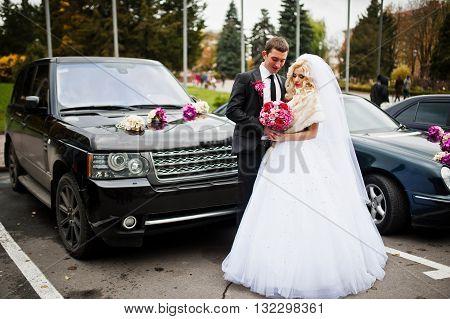 Wedding couple background cars cortege at wedding