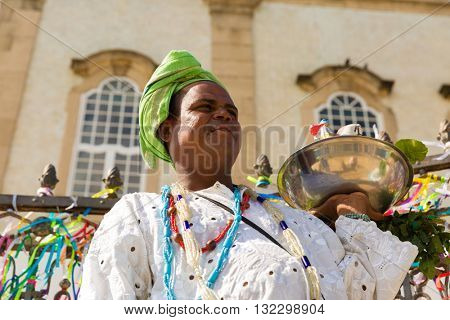 Brazilian man wearing traditional clothes at Bonfim Church in Salvador, Bahia, Brazil