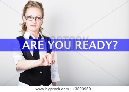 are you ready written on a virtual screen. Internet technologies in business and tourism. woman in business suit and tie, presses a finger on a virtual screen.