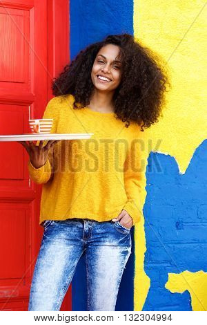 Smiling Waitress Holding Up Coffee Cup On A Tray