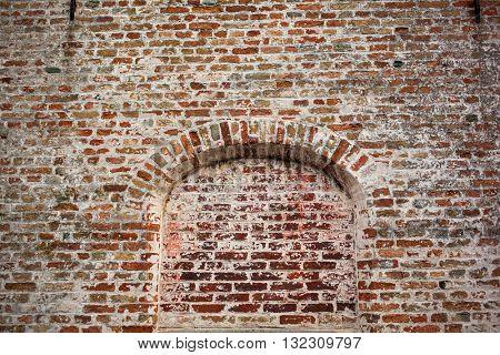 bow window on brick wall