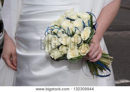 Wedding Bouquet, Cream Roses Flowers In Hands Of Bride