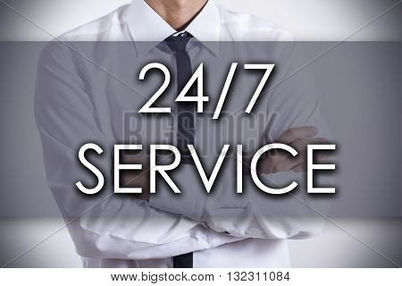 24/7 Service - Young Businessman With Text - Business Concept