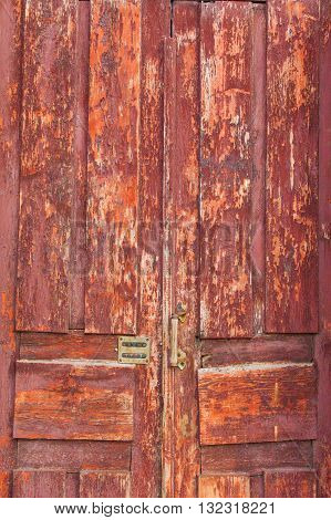 Old Weathered Wooden Door with Modern Combination Lock