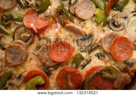 Sicilian pizza with sausage onions peppers mushrooms and pepperoni
