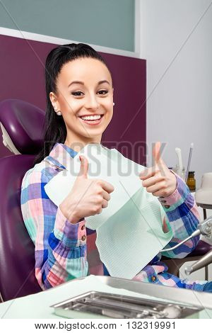 Woman With White Teeth With Thumbs Up Waiting For Dentist