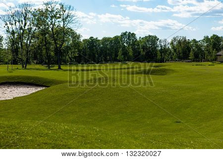 Gorgeous view at beautiful golf course with sand bunker. View nature landscape of beautiful golf course.