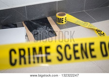 latent footprint evidence with blurred crime scene tape