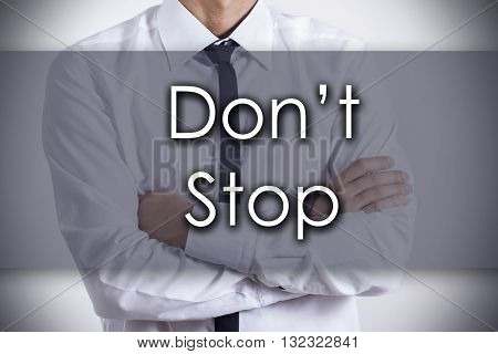 Don't Stop - Young Businessman With Text - Business Concept