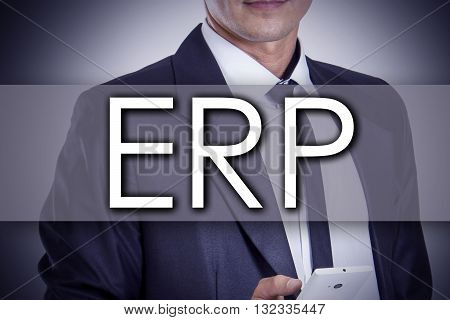 Enterprise Resource Planning Erp - Young Businessman With Text - Business Concept