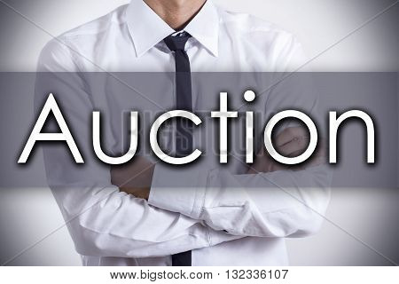 Auction - Young Businessman With Text - Business Concept