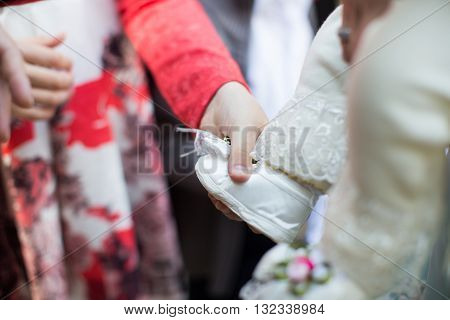 holding baby hand during christening Orthodox baptism