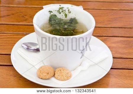 Herbal Tea Bag in cup closeup photo