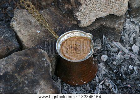 Ember Turkish coffee. Roasted Turkish coffee. Traditional nubian coffee making. Coffee turk on the coal.