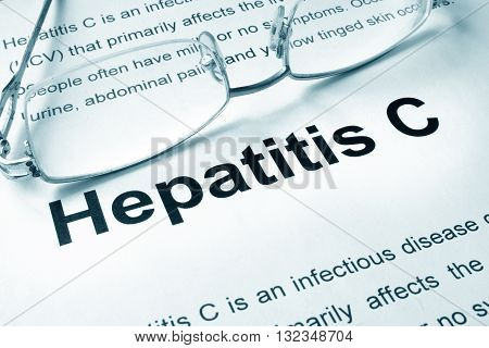 Hepatitis C written on a page. Medical concept.