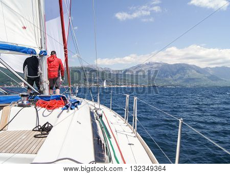 Tivat, Montenegro - 26 April, The yacht with people running toward the shore, 26 April, 2016. Regatta