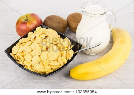 Jug Of Milk, Bowl With Corn Flakes And Fruits