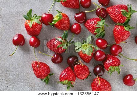 Cherry And Strawberry On Stone Table, From Above