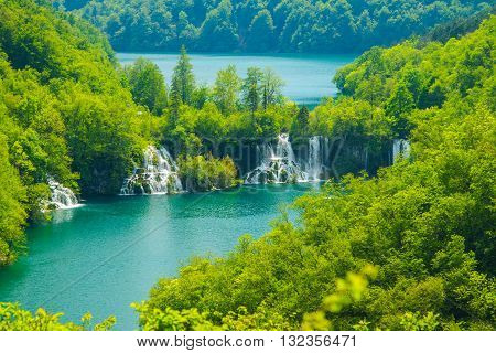 Beautiful landscape, waterfall and clear green water in the Plitvice Lakes National Park in Croatia, beautiful world