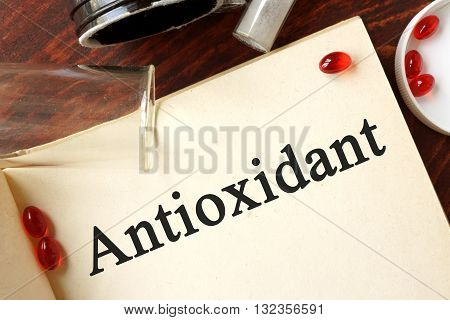 Antioxidant written on a page. Chemistry concept.