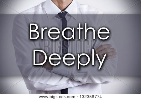 Breathe Deeply - Young Businessman With Text - Business Concept