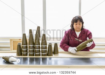 Worker At An Assembly Line In Munition Factory