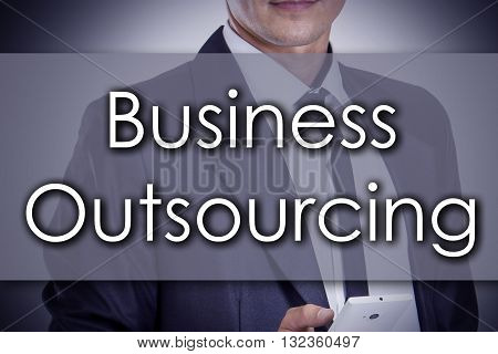 Business Outsourcing - Young Businessman With Text - Business Concept