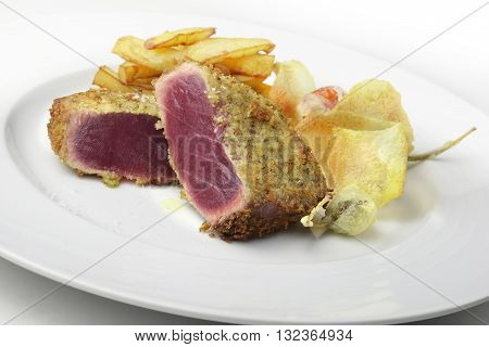 Fish dish portion escalope bluefin tuna breading capers and potatoes