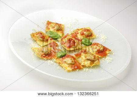 Isolated Pasta dish Ravioli stuffed with eggplant parmigiana