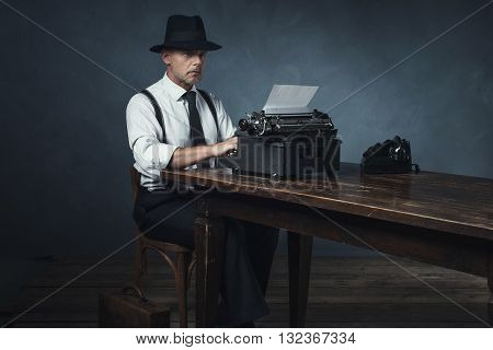 Vintage 1940 Office Worker Behind Desk With Typewriter And Telephone.