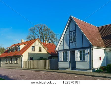 Houses With Wooden Fence In Ventspils Of Latvia