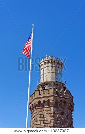 Navesink Twin Lights And Flag At Sandy Hook In Nj