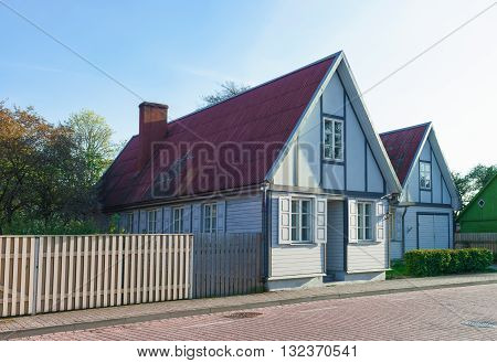Old Wooden House With Wooden Fence In Ventspils Of Latvia