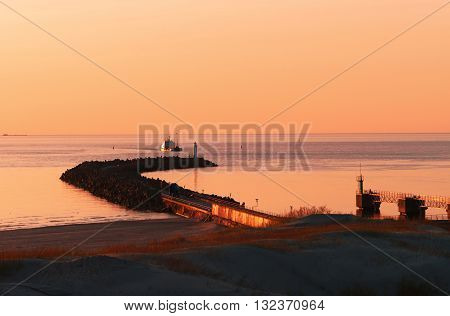 Sunset At The Pier On Baltic Sea In Ventspils