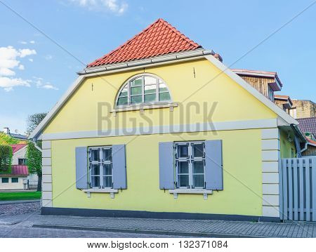 Yellow Painted Old House In Ventspils Of Latvia