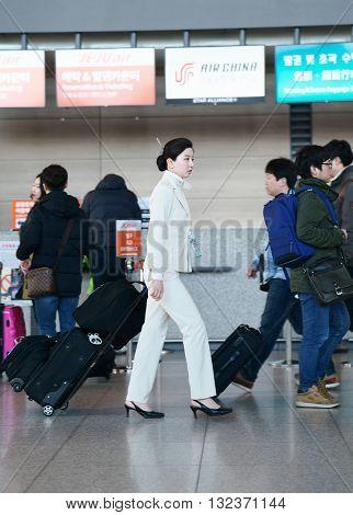 Asian Female Flight Attendant In The Incheon International Airport