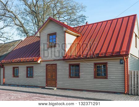 Building With A Red Roof In Ventspils In Latvia
