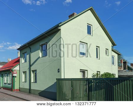 Green House With A Green Fence In Ventspils In Latvia