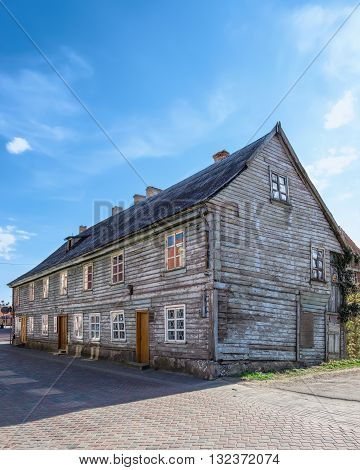 Old Wooden House In The Streets Of Ventspils In Latvia